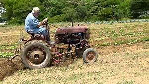 Cultivating A Field On A 1950 U0026 39 S Farmall Cub