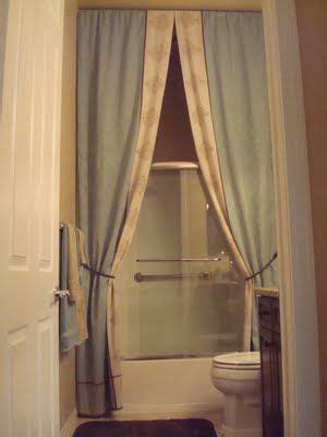 hang shower curtain at ceiling level bathroom