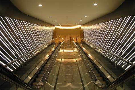 illuminated form resin  wood escalator feature wall panels gpi design