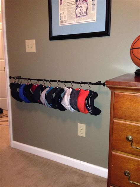 hat rack ideas diy hat rack i used a curtain rod shower curtain hooks and office clips your welcome bro