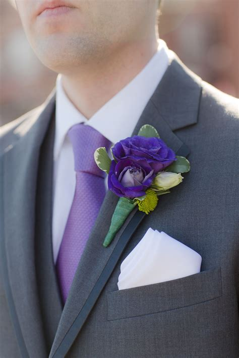 purple rose  lisianthus boutonniere