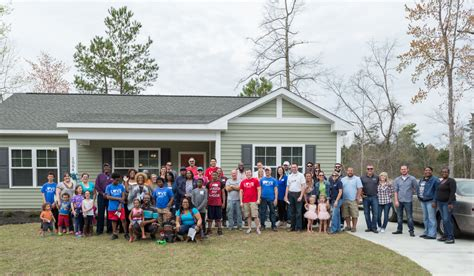 stage habitat for humanity home dedication in