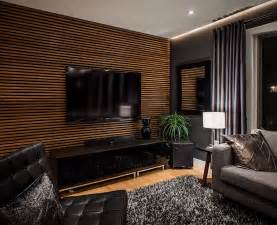modernes wohnzimmer schwarz modernes wohnzimmer schwarz mit tv wanpaneel holz und schwarze möbelstücke freshouse