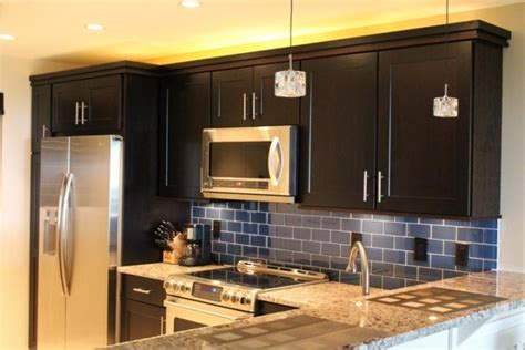 Modern Above Kitchen Cabinet Decor by Navy Blue Backsplash Ideas With Cute Pendant Lamp For