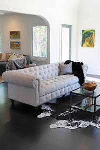 Cowhide Rug and Linen Chesterfield Sofa - Eclectic