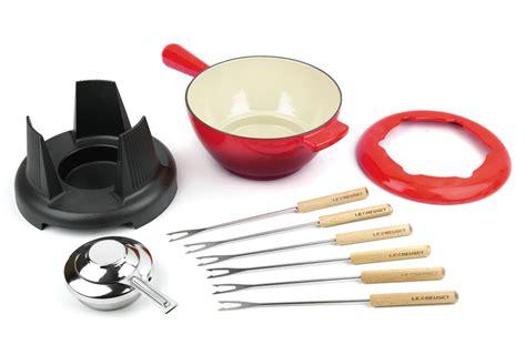 le creuset cast iron fondue set  quart cherry red cutlery
