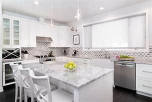 white kitchen cabinets with white quartzite