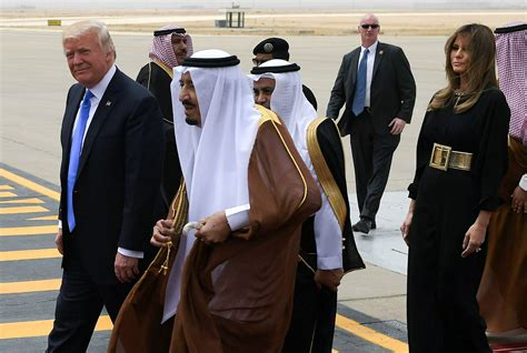 trump arabia saudi donald salman president visits melania bin king abdulaziz foreign trip bowing he carpet walking diplomacy him