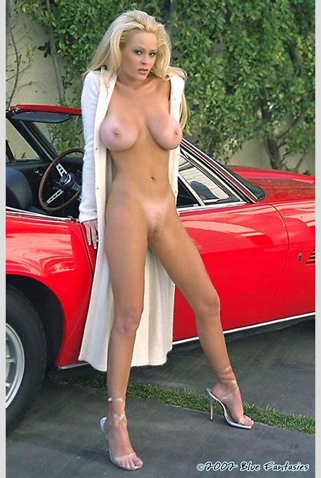 Busty pornstar Laura Shay Selway performing a nice stripping dance by the red expensive car.