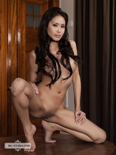A Beautiful Asian With Perky Naked Tits Stands In Front Of