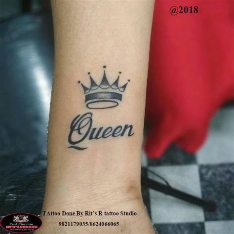 small crown  word queen tattoo  forearm