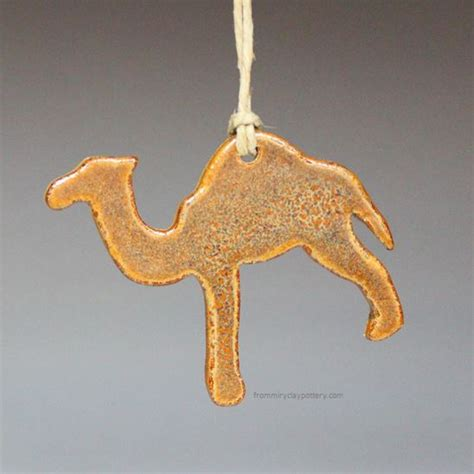 handmade pottery camel ornament by from miry clay pottery