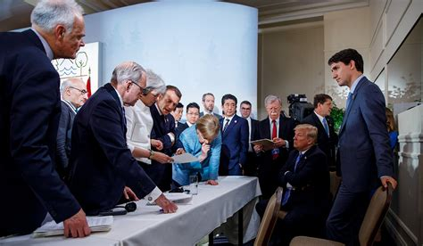The summit was dubbed the g6 plus one due to the billionaire tycoon's isolation over trade and his decision to pull the us out of the iran nuclear deal. That Merkel-Trump Photo From The G7 Summit That Has ...