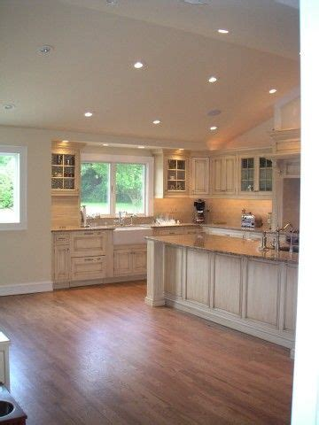 vaulted kitchen ceiling with transom window above sink