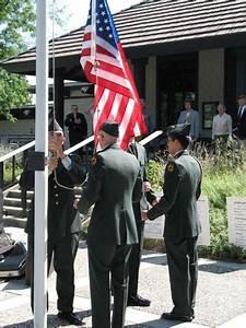A Uc Davis Army Rotc Color Guard Raises The Flag At The