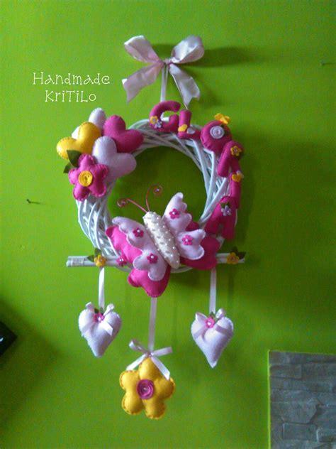 fiori nascita ghirlanda fiocco nascita con farfalla cuori e fiori
