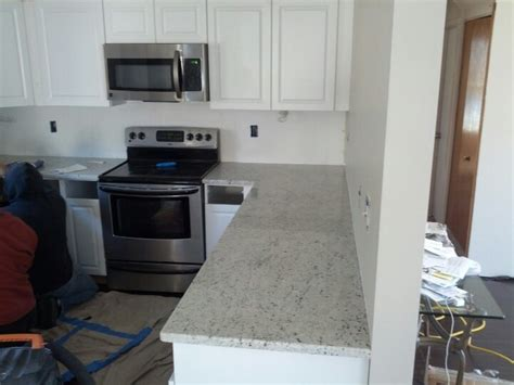 kitchen colonial white granite white cabinets granite