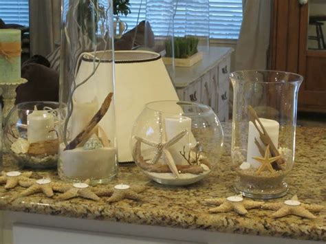 Glass Cylinders, Vases & Bowls Filled With Rocks, Sand