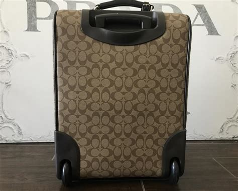 coach brown tan canvas leather rolling luggage weekendtravel bag tradesy