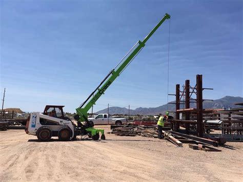skidcrane lives   family    contractor  bringing  skid steer crane