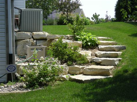 landscape a hill what kind of landscaping for a hill landscaping rochester mn rocksolidlandscape com