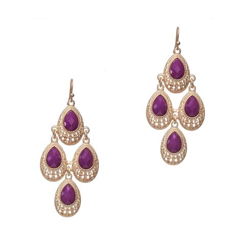 ingenious gold chandelier earrings with purple stones