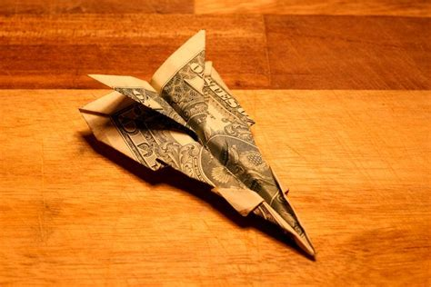 Paper plane coffee co., montclair, new jersey. Dollar Bill Origami: Fighter Jet Tutorial   Make a paper airplane, Barrel coffee table, Dollar ...