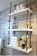10 Cool Ways To Decorate With Suspended Shelves 3 Bathroom Shelves Bathroom Shelves With Barn Door Bathroom Shelves Floating Shelves Industrial Shelves