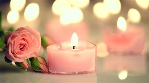 jar flower arrangement candles and roses for background of dried