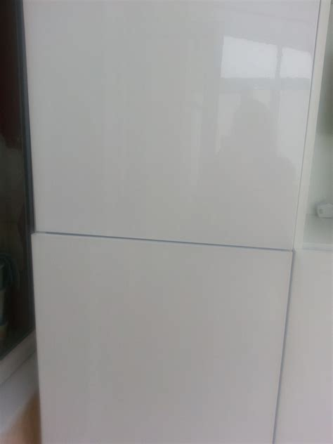 Build cabinet around stacked washer tumble dryer