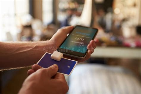 Pay with your visa, mastercard, or. Credit Card Payment App Attached To Mobile Phone Stock ...