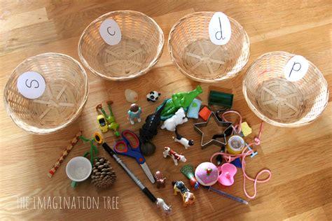 sorting baskets phonics activity the imagination tree 853 | Sort objects into phonics baskets