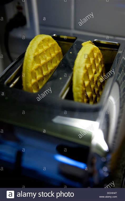 Waffles In The Toaster - two kellog s eggo breakfast waffles in a toaster stock