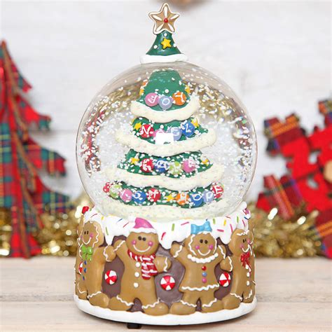 traditional christmas snowglobes tree gingerbread musical snow globe dome by berry apple notonthehighstreet