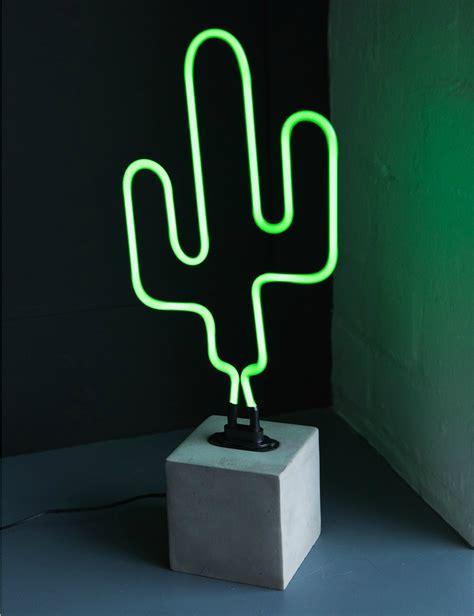 neon cactus light at grey