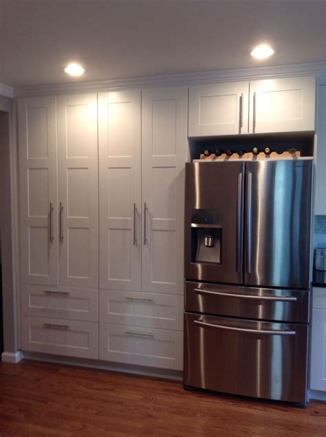 Double white ikea pantry. Samsung stainless steel French