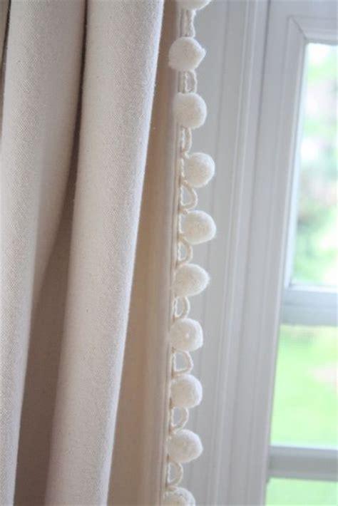 black curtains  cream pom pom trim baby girl