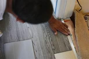 installing gray color trafficmaster ultra vinyl plank for remodelling living room design