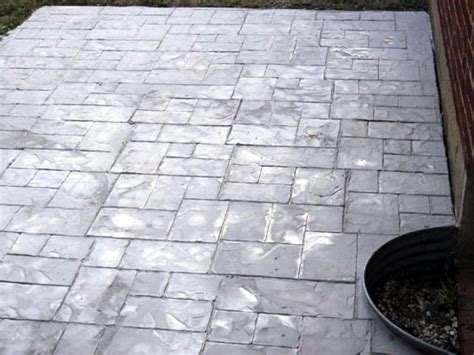 enhance an existing patio with concrete sting hgtv