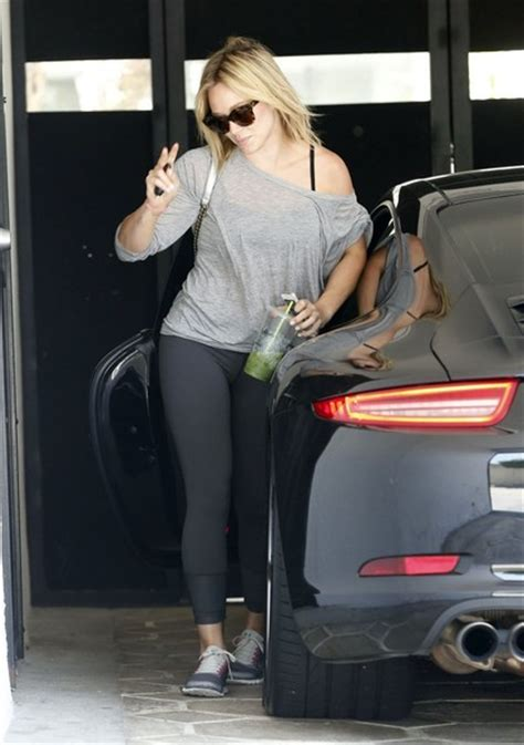 hilary duff drives  porsche    gym