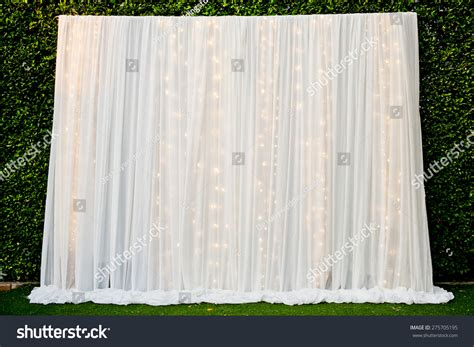 white see through fabric curtain decorate with the lights