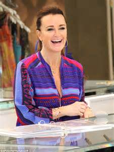 Kyle Richards brightens up in red and purple striped top