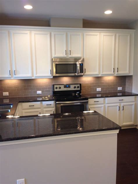 kitchen white cabinets tan subway tile backsplash