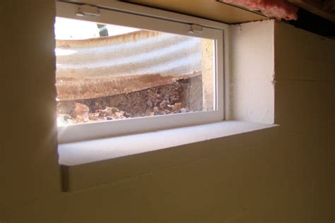 Finishing Window Sills by New Thermopane Basement Windows By Jim Homerefurbers