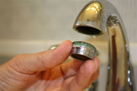 how to replace the kitchen faucet clean a faucet aerator for better water plumbing
