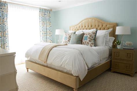 Beige And Blue Bedroom With Greek Key Nightstand