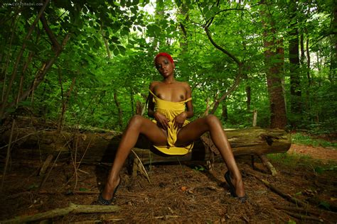 beautiful nude black girl outdoors in the woods