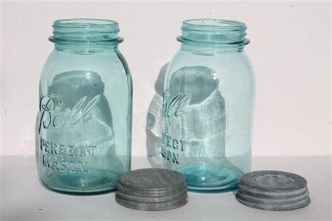 primitive wire rack jar carriers  wooden handles  blue glass ball mason jars