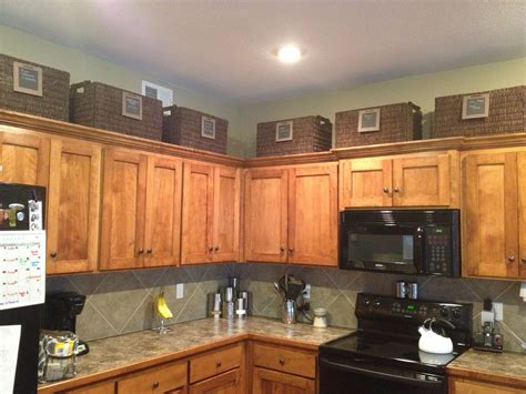 Kitchen Cupboard Tops by Baskets Above Cabinets For More Storage Organization In