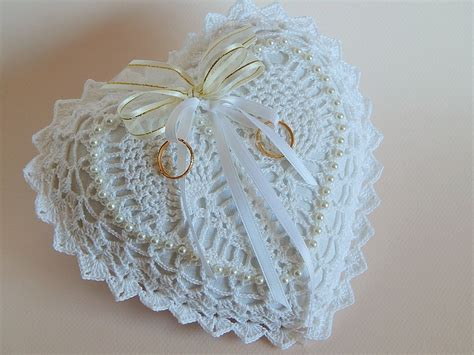 white shaped crocheted lace ring bearer pillow